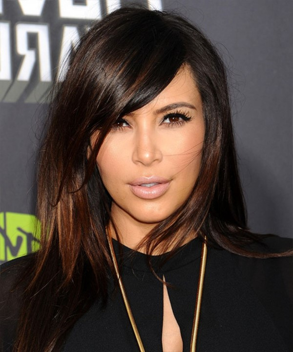 Kim Kardashian long straight hairstyle with long side bangs