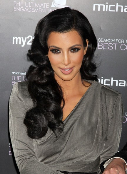 Kim Kardashian long voluminous curly hairstyle