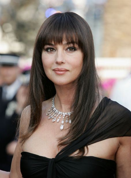 Monica Bellucci long hairstyle with straight fringe for round face