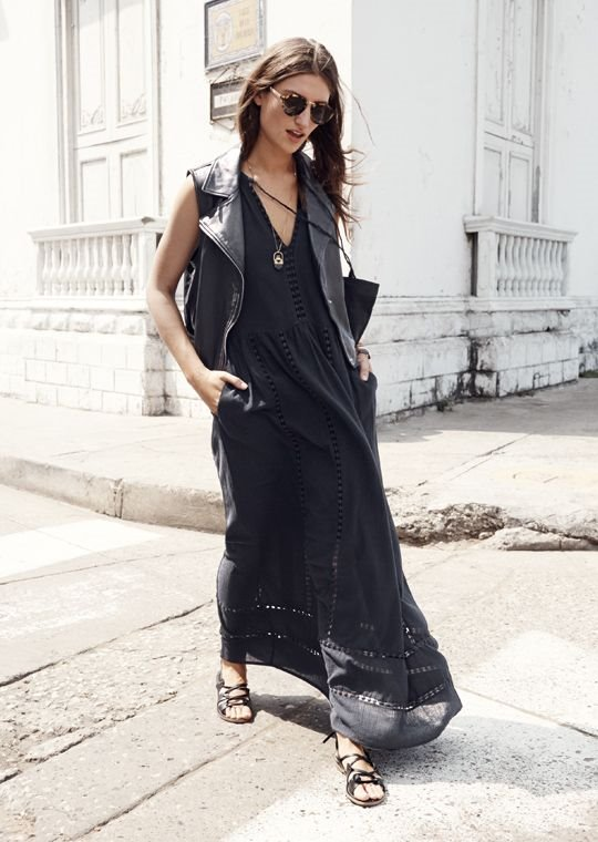 long black dress, roman sandals, leather vest