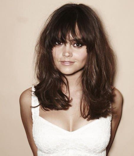 Jenna Coleman hairstyles for a wide round face: medium layered with soft straight bangs