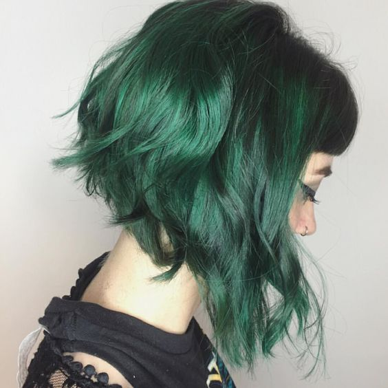 Green  hair color ideas - deep forest green messy wavy asymmetric bob